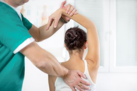 Woman Receiving Therapy for Shoulder Pain