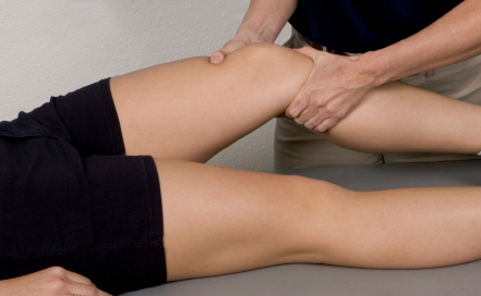 Person Receiving Knee Pain Treatment